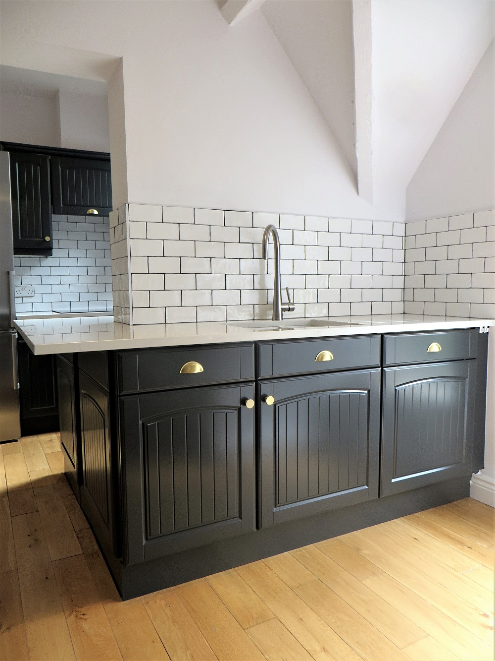 The finished kitchen painted in a deep charcoal colour