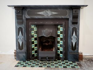 The completed faux finish paint effect on the Victorian slate fireplace