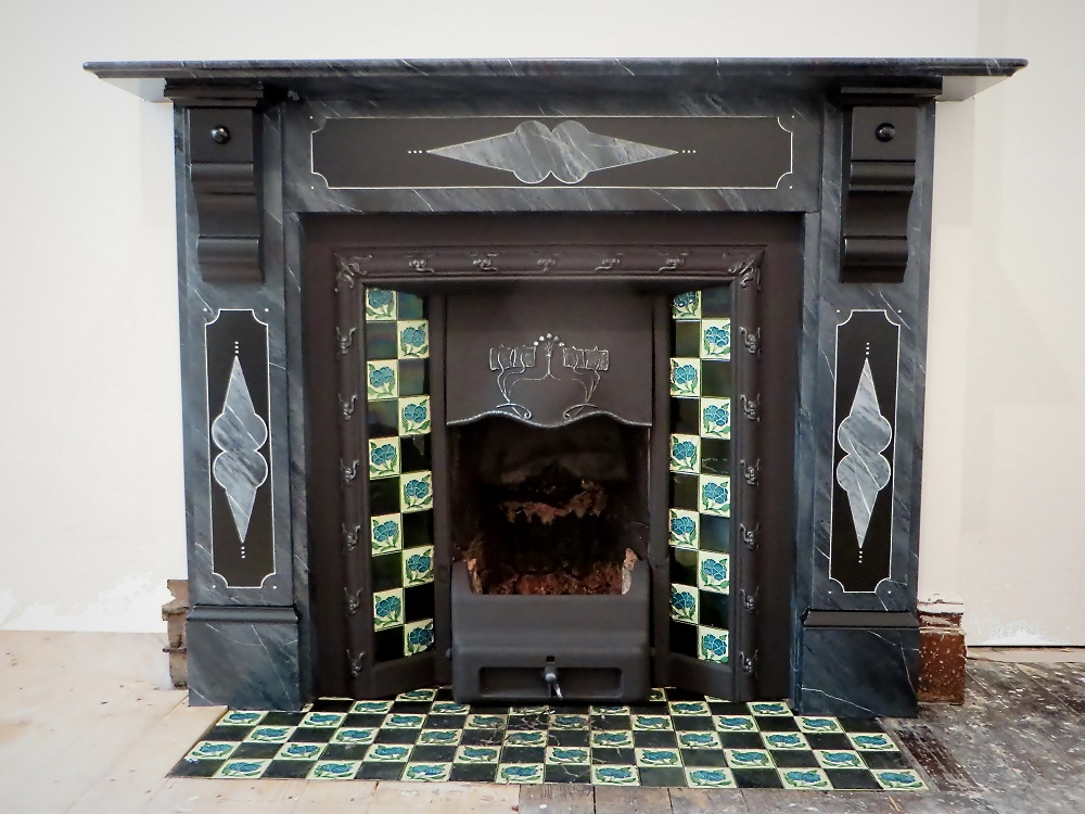 The finished marble paint effect fire surround