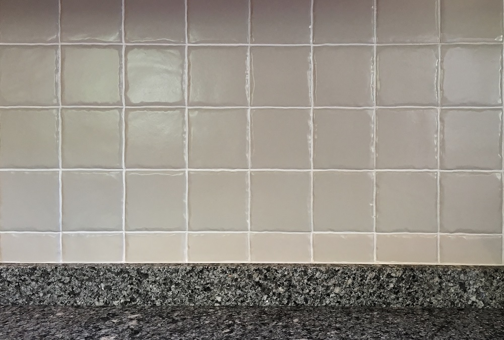 Close up of the painted tiles and re-established grout lines