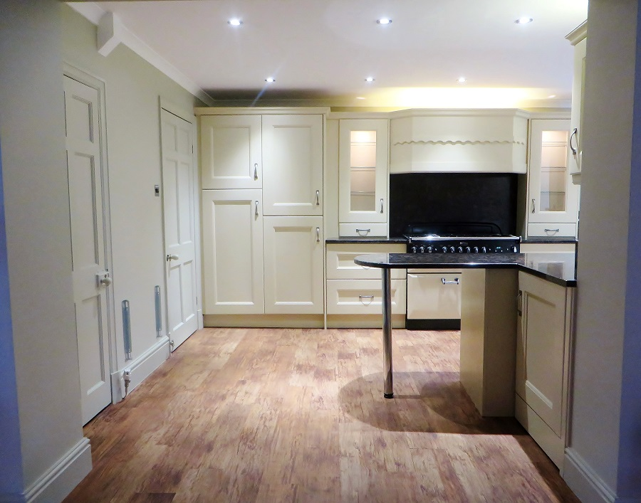 Part of the kitchen - quite the hand painted transformation!
