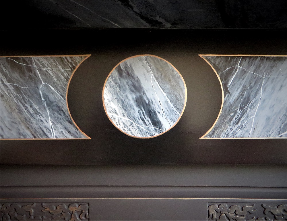 Close up of the central imitation marble panel